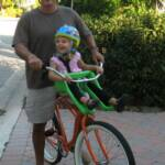 Brielle (3) going for a ride in one of our Front-Mounted Child Seats on a Men's Beach Cruiser.